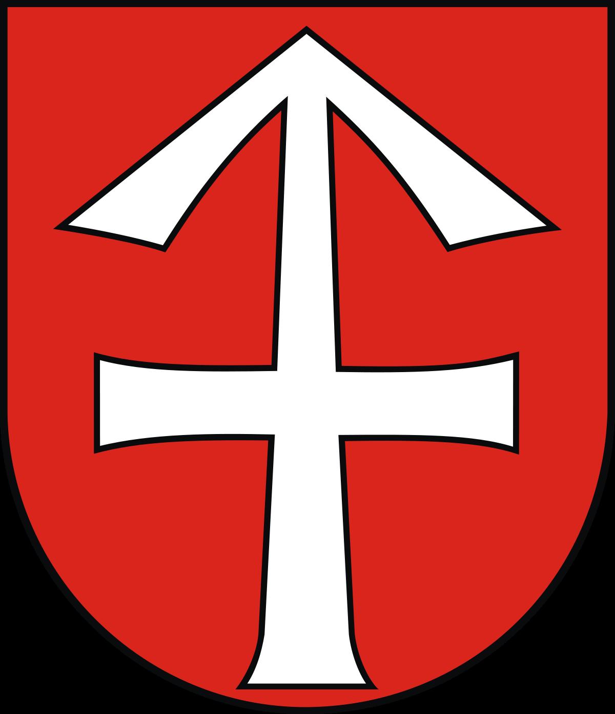 Herb przedstawia w polu czerwonym rogacinę srebrną w słup, w środku raz przekrzyżowaną.