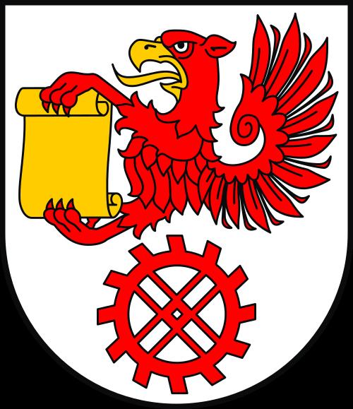 Na obrazku znajduje się herb Gminy Kępice. Herb Kępic przedstawia w polu srebrnym pół gryfa czerwonego o dziobie i języku złotym, trzymającego w szponach złotą kartę papieru, ponad czerwonym kołem wodnym.